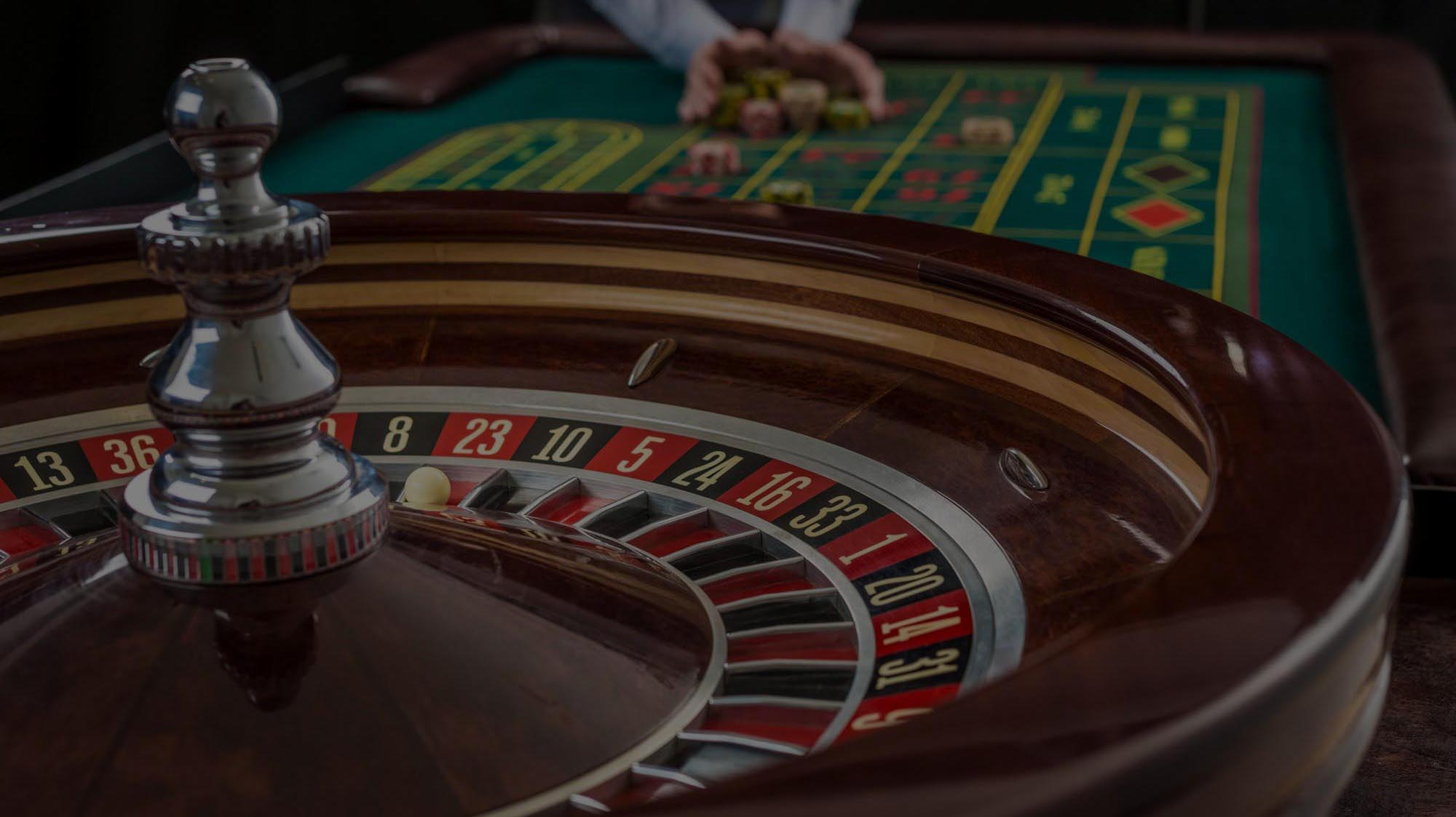 bigstock-Roulette-and-piles-of-gambling-121861334-1